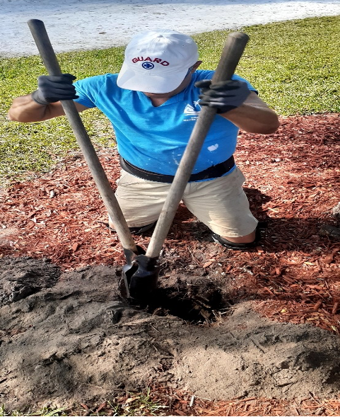 man digging hole for bench